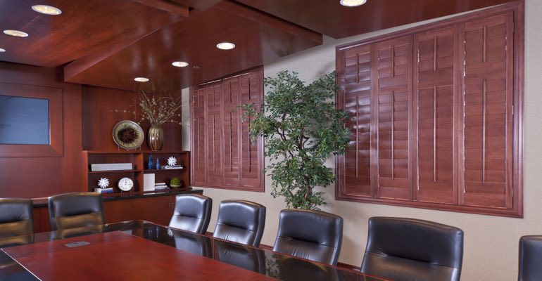 Wooden shutters covering a conference rooms' windows
